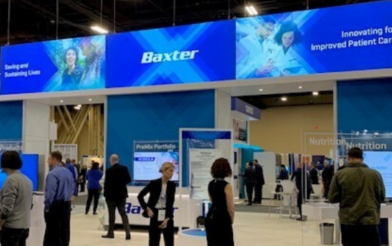 People visiting Baxter's booth at ASHP 2019